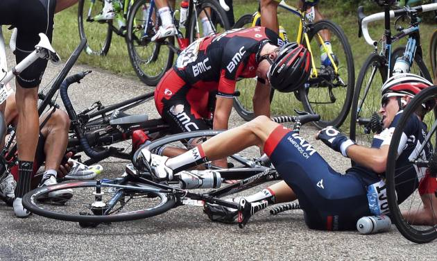 Tejay van Garderen of the U.S., center top, and Switzerland's Sebastien Reichenbach, right, crash during the seventh stage of the Tour de France cycling race over 234.5 kilometers (145.7 miles) with start in Epernay and finish in Nancy, France, Friday, July 11, 2014. (AP Photo/Fred Mons, Pool)