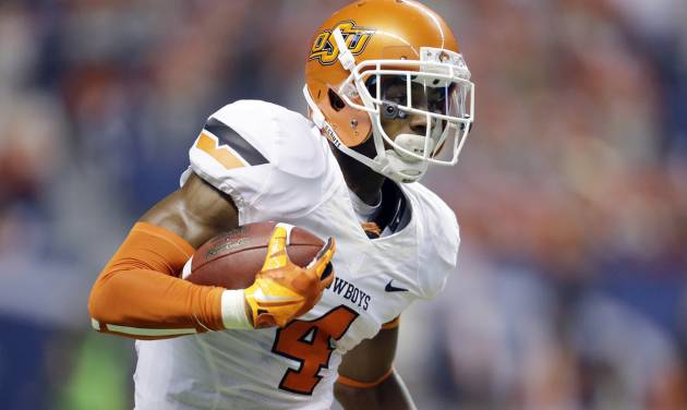 Oklahoma State's Justin Gilbert returns a kick off against Texas San Antonio during the first half of an NCAA college football game, Saturday,  Sept. 7, 2013, in San Antonio. (AP Photo/Eric Gay) ORG XMIT: TXEG103