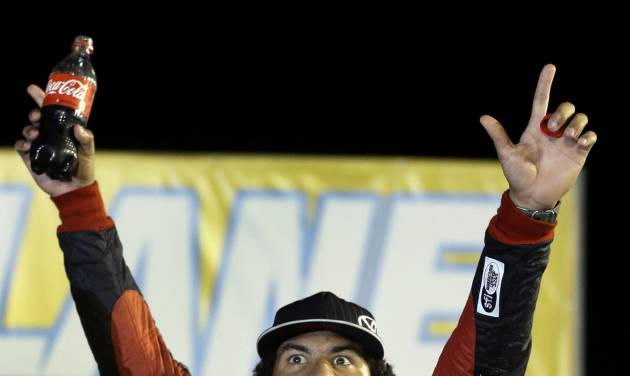 Darrell Wallace Jr. celebrates after winning the NASCAR Truck Series auto race at Gateway Motorsports Park on Saturday, June 14, 2014, in Madison, Ill. (AP Photo/Jeff Roberson)