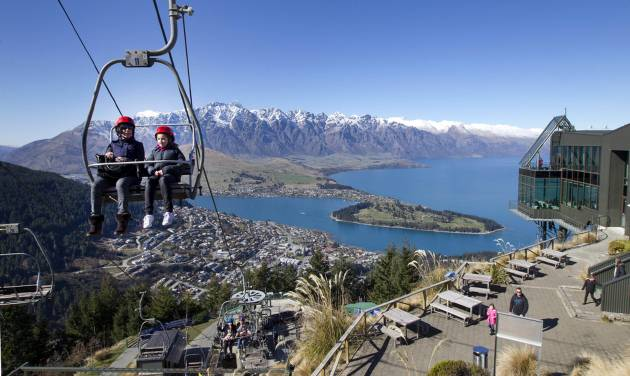 In this Aug. 30,  2013 photo,  visitors ride a Skyline gondola in a bright sunny winter day at Queenstown, Lake Wakatipu and the Remarkables, in the South Island of New Zealand. Scientists said Tuesday Sept. 3, 2013, the South Pacific nation had its warmest winter since record-keeping began more than a century ago.(AP Photo/New Zealand Herald, Mark Mitchell) AUSTRALIA OUT, NEW ZEALAND OUT