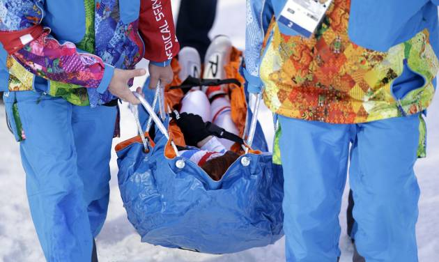 France's Marie Laure Brunet is carried away after collapsing during her second-kilometer lap, during the women's biathlon 4x6k relay at the 2014 Winter Olympics, Friday, Feb. 21, 2014, in Krasnaya Polyana, Russia. (AP Photo/Lee Jin-man)