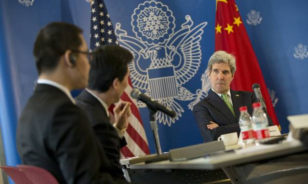 U.S. Secretary of State John Kerry, right, listens to a question during a discussion with Chinese bloggers on a number of issues, including internet freedom, Chinese territorial disputes with Japan, North Korea, and human rights, on Saturday, Feb. 15, 2014, in Beijing, China. (AP Photo/Evan Vucci, Pool)