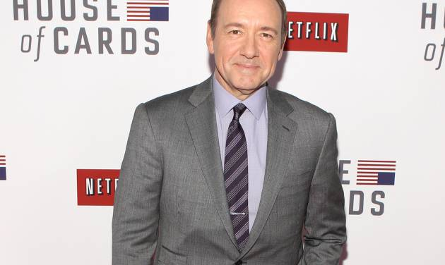 """FILE - This Jan. 29, 2013 file photo shows actor Kevin Spacey at the premiere of Netflix's first original series, """"House of Cards,"""" in Washington. Spacey and Dana Brunetti will be honored with a Webby Special Achievement Award for their role in creating and producing the groundbreaking series. The ceremony will available to view in HD on Watch.WebbyAwards.com on Wednesday, May 22, 2013. (Photo by Paul Morigi/Invision/AP, File)"""