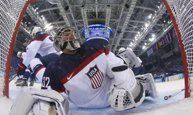 USA goaltender Jonathan Quick slides headfirst in to the goal while defending against Slovakia during the second period of the men's ice hockey game at the 2014 Winter Olympics, Thursday, Feb. 13, 2014, in Sochi, Russia. (AP Photo/Martin Rose, Pool)
