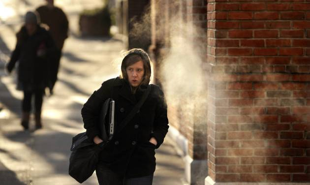 Sarah Klinetob, a Penn State University research assistant, walks through the bitter cold Tuesday, Jan. 22, 2013 on her way to campus along Allen Street, in downtown State College, Pa. Temperatures in State College were in the single digits with wind chills in the negative numbers Tuesday.  (AP Photo/Centre Daily Times,Nabil K. Mark) MANDATORY CREDIT; MAGS OUT