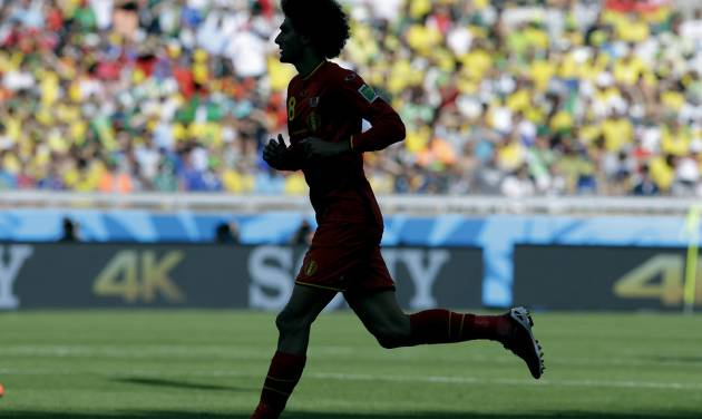 Belgium's Marouane Fellaini runs onto the pitch after coming on as a substitute during the group H World Cup soccer match between Belgium and Algeria at the Mineirao Stadium in Belo Horizonte, Brazil, Tuesday, June 17, 2014. (AP Photo/Hassan Ammar)