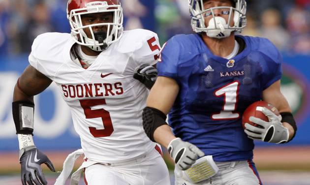 Oklahoma's Joseph Ibiloye (5) chases down Kansas' Jake Sharp (1) during the first half of the college football game between the University of Oklahoma Sooners (OU) and the University of Kansas Jayhawks (KU) on Saturday, Oct. 24, 2009, in Lawrence, Kan. Photo by Chris Landsberger, The Oklahoman