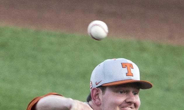 Texas starting pitcher Chad Hollingsworth delivers against UC Irvine in the first inning of an NCAA baseball College World Series elimination game in Omaha, Neb., Wednesday, June 18, 2014. (AP Photo/Nati Harnik)