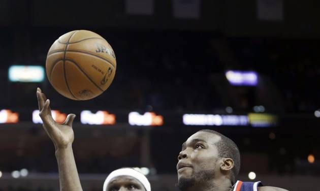 Atlanta Hawks' Paul Millsap (4) grabs a pass in front of Memphis Grizzlies' Zach Randolph (50) in the first half of an NBA basketball game in Memphis, Tenn., Sunday, Jan. 12, 2014. (AP Photo/Danny Johnston)
