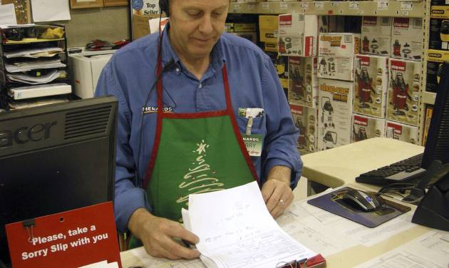 Larry Boutilier, hardware manager, who has been with the Minot, N.D. Menards since 1996, looks over paperwork at the storey in Thursday, Nov. 29, 2012. The home improvement retailer says it will hire workers from its home base in Wisconsin and fly them to North Dakota to staff a store in Minot, which is near the state's booming oil patch and has more jobs than takers. (AP Photo/The Minot Daily News, Jesse D. Watson)