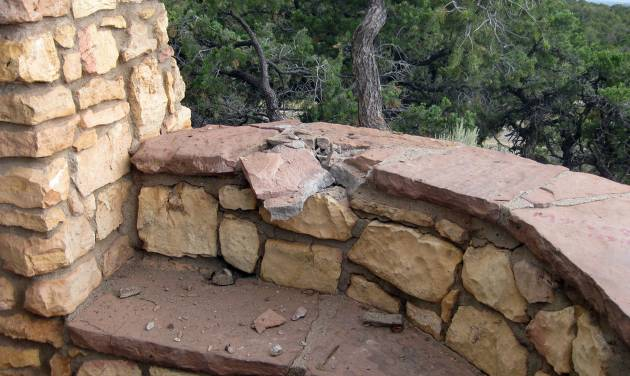 This Wednesday, July 24, 2013 photo provided by the Coconino County Sheriff's Office shows the rock wall believed to be where a victim was sitting when lighting stuck Tuesday at the Le Fevre Overlook on Highway 89A, some 8 miles north of Jacobs Lake, Ariz. A married couple was killed and a teenage boy injured when the lightning struck, authorities said Wednesday. (AP Photo/Coconino County Sheriff's Office)