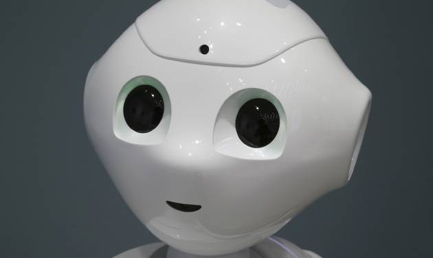 """Humanoid Robot """"Pepper"""" is displayed at SoftBank Mobile shop in Tokyo, Friday, June 6, 2014. The 121 centimeter (48 inch) tall, 28 kilogram (62 pound) white Pepper, which has no hair but two large doll-like eyes and a flat-panel display stuck on its chest, was developed jointly with Aldebaran Robotics, which produces autonomous humanoid robots. (AP Photo/Koji Sasahara)"""