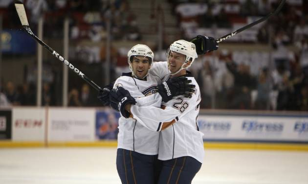 Oklahoma City's Justin Schultz (5) and Martin Marincin (28) celebrate after scoring a goal during a game between the Oklahoma City Barons and the San Antonio Rampage at the Cox Convention Center in Oklahoma City, Friday, Oct. 19, 2012.  Photo by Garett Fisbeck, The Oklahoman