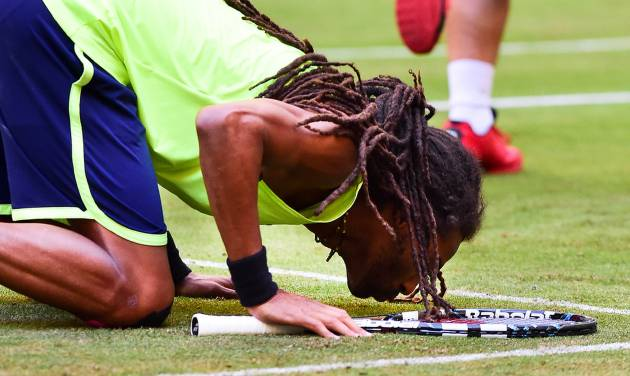 Germany's Dustin Brown celebrates his victory against Spain's Rafael Nadal during the Gerry Weber Open tennis tournament in Halle, Germany, Thursday, June 12, 2014. Brown won the match with 6-4 and 6-1. (AP Photo/dpa,Christian Weische)