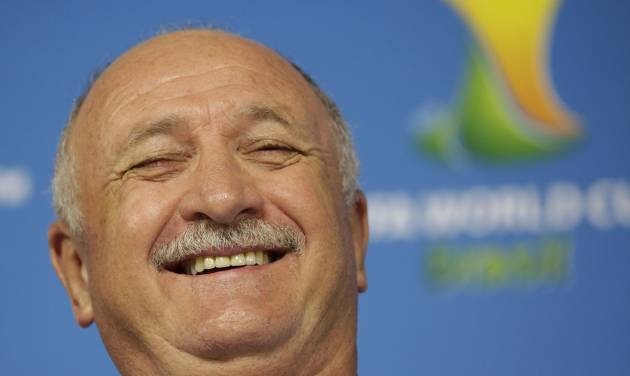 Brazil's coach Luiz Felipe Scolari laughs during a press conference one day before the group A World Cup soccer match between Brazil and Croatia at the Itaquerao Stadium in Sao Paulo, Brazil, on Wednesday, June 11, 2014. (AP Photo/Felipe Dana)
