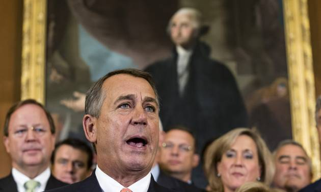 """Speaker of the House John Boehner, R-Ohio and Republican members of the House of Representatives rally after passing a bill that would fund the government for three months while crippling the health care law that was the signature accomplishment of President Barack Obama's first term, at the Capitol in Washington, Friday, Sept. 20, 2013. Senate Majority Leader Harry Reid, D-Nev., has pronounced the bill dead on arrival and calls the House exercise a """"waste of time.""""   (AP Photo/J. Scott Applewhite)"""