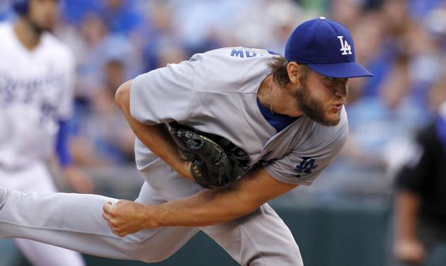 Los Angeles Dodgers pitcher Clayton Kershaw throws to a batter in the first inning of a baseball game against the Kansas City Royals at Kauffman Stadium in Kansas City, Mo., Tuesday, June 24, 2014. (AP Photo/Colin E. Braley)