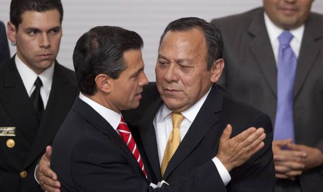 "FILE - In this March 11, 2013 photo, Mexico's President Enrique Pena Nieto, left, embraces President of the Democratic Revolution Party (PRD) Jesus Zambrano at an event to sign an agreement that would create two new national television channels and form an independent regulatory commission in Mexico City. Mexico's government proposed a sweeping overhaul of the banking sector Wednesday, May 8, 2013, which is supported by Zambrano's PRD.  Pena Nieto said ""The object is ... for banks to lend more, and more cheaply."" Critics warned it could launch a wave of foreclosures like those seen in Spain and the United States, while supporters said it is needed to spur banks to lend to Mexico's credit-starved businesses.  (AP Photo/Alexandre Meneghini, File)"