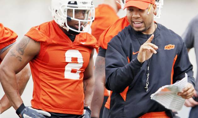 OSU running backs coach Robert Gillespie, right, talks with Beau Johnson during a spring practice in March. Gillespie isn't known for his gentle style of coaching. (Photo by Nate Billings, The Oklahoman)