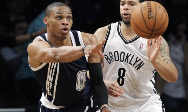 Oklahoma City Thunder guard Russell Westbrook (0) passes as Brooklyn Nets guard Deron Williams (8) defends in the first half of their NBA basketball game at Barclays Center, Tuesday, Dec. 4, 2012, in New York. (AP Photo/Kathy Willens) ORG XMIT: NYKW104