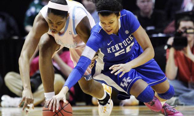 Kentucky's Azia Bishop, right, battles for the ball with Tennessee's Vicki Baugh (21) in the first half of an NCAA college basketball game on Monday, Feb. 13, 2012, in Knoxville, Tenn. (AP Photo/Wade Payne)