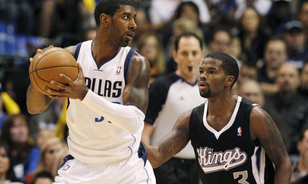 Dallas Mavericks' O.J. Mayo (32) looks for an opening against Sacramento Kings' Aaron Brooks (3) in the first half of an NBA basketball game Monday, Dec. 10, 2012, in Dallas. (AP Photo/Tony Gutierrez)