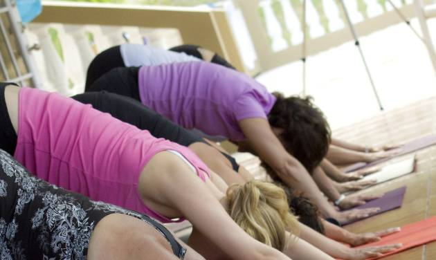 This March 2011 photo released by Just Love Photography shows a yoga session in Rincon, Puerto Rico, at a retreat created by Jessica Bellofatto of KamaDeva Yoga and Gina Bradley of Paddle Diva. The program is an example of active vacations tailored to travelers who value healthy lifestyles and new experiences. (AP Photo/Evelyn O'Doherty/Just Love Photography)