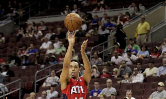 Atlanta Hawks' John Jenkins (12) shoot against the Philadelphia 76ers in the first half of an NBA basketball game, Wednesday, April 10, 2013, in Philadelphia. (AP Photo/H. Rumph Jr)