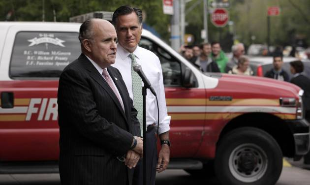 Republican presidential candidate, former Massachusetts Gov. Mitt Romney, center, listens as former New York City Mayor Rudy Giuliani speaks during a news conference in front of Engine 24, Ladder 5 in New York, Tuesday, May 1, 2012. (AP Photo/Jae C. Hong)