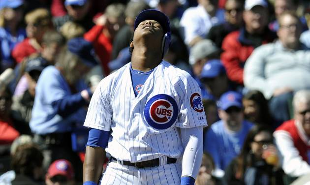 Chicago Cubs' Starlin Castro reacts after swing at a pitch in the dirt against the St. Louis Cardinals during the fourth inning of a baseball game Saturday, Sept. 22, 2012, in Chicago. (AP Photo/Jim Prisching)
