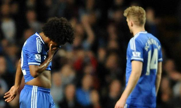 Chelsea's Willian, left, leaves the pitch after being sent off during the English Premier League soccer match between Aston Villa and Chelsea at Villa Park, Birmingham, England, Saturday, March 15, 2014.  (AP Photo/Rui Vieira)