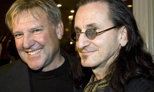 FILE - Alex Lifeson, left, and Geddy Lee of the rock band RUSH arrive for the Canadian Music Industry Awards in Toronto,in this Thursday, March 8, 2007 file photo. Rush is among the group of first-time nominees for the Rock and Roll Hall of Fame.(AP Photo/CP, Frank Gunn, File)