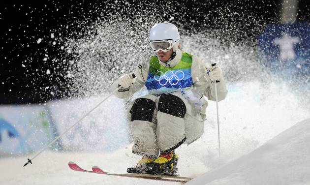 In this Feb. 14, 2010 photo, Dale Begg-Smith of Australia makes his moguls final run at the Vancouver 2010 Olympics in Vancouver, British Columbia. Begg-Smith said he's ready to chase after another Olympic medal after taking nearly three years off to rest his aching body. The 29-year-old moguls skier captured gold at the 2006 Turin Games and silver four years later in Vancouver. Given his long layoff, he knows he's not the favorite at the Sochi Olympics, but likes the underdog role. (AP Photo/Mark J. Terrill)