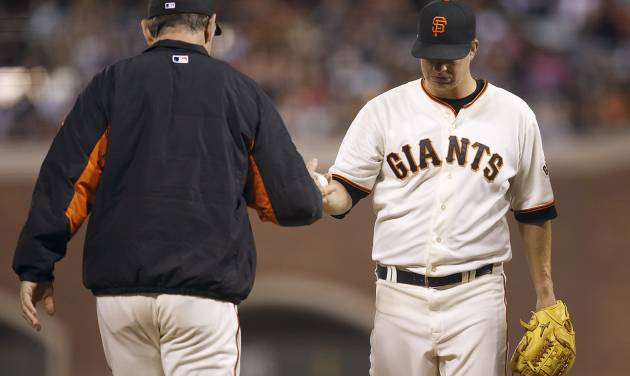 San Francisco Giants pitcher Matt Cain, right, is taken out of the game by  manager Bruce Bochy during the eighth inning against the San Diego Padres in a baseball game in San Francisco, Monday, June 23, 2014. (AP Photo/Tony Avelar)
