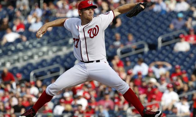 Washington Nationals starting pitcher Stephen Strasburg throws during the fourth inning of a baseball game against the Miami Marlins at Nationals Park on Thursday, April 10, 2014, in Washington. (AP Photo/Alex Brandon)