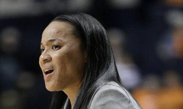 FILE - In this March 2, 2012 file photo, South Carolina head coach Dawn Staley watches her team in the first half of an NCAA college basketball game against Georgia at the women's Southeastern Conference tournament in Nashville, Tenn. Staley's got a busy summer ahead. That's the only way the coach knows how to take advantage of the her rising team's NCAA tournament success from last winter. (AP Photo/Mark Humphrey, File)