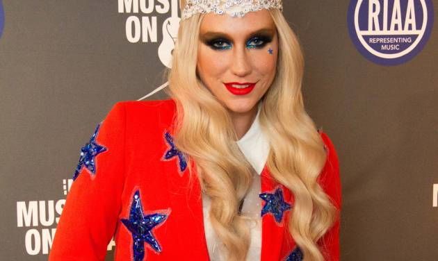 Ke$ha arrives at the 2013 Presidential Inaugural Charity Benefit, on Monday, Jan. 21, 2013 in Washington. (Photo by Stephen Boitano/Invision/AP)