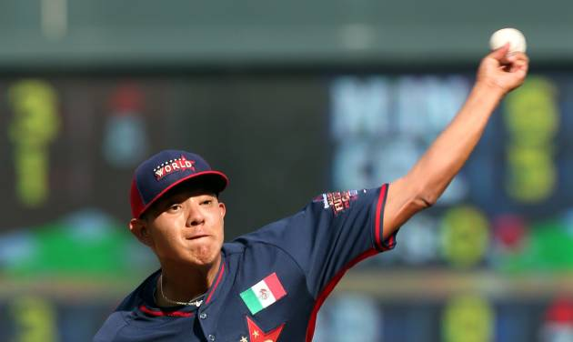 World's Julio Urias throws a pitch during the fifth inning of the All-Star Futures baseball game against the United States, Sunday, July 13, 2014, in Minneapolis. (AP Photo/Jim Mone)