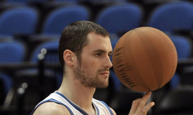 "In this Oct. 1, 2012 photo, Minnesota Timberwolves NBA star basketball player Kevin Love spins a ball for the team photographer during media day in Minneapolis. Love is beginning the first season of a four-year, $60 million contract extension and says when ""people think of the Minnesota Timberwolves, i want them to think Kevin Love."" (AP Photo/Jim Mone)"