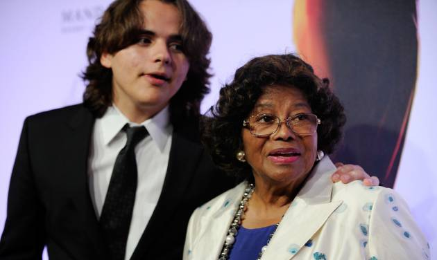 "FILE - In this June 29, 2013 file photo, Prince Jackson, left, and Katherine Jackson arrive at the world premiere of ""Michael Jackson ONE"" at THEhotel at Mandalay Bay Resort and Casino in Las Vegas. Jackson's 2002 will calls for his estate to support his mother, Katherine, and his three children, while leaving nothing for his siblings and his father. Through the end of 2012, Jackson's estate paid nearly $20 million to support his mother and children. (Photo by David Becker/Invision/AP, File)"