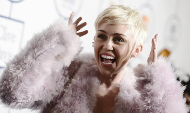"""FILE - In this Jan. 25, 2014 file photo, Miley Cyrus arrives at the 56th annual GRAMMY awards - salute to industry icons with Clive Davis, in Beverly Hills, Calif. Cyrus is in the hospital and unable to perform her """"Bangerz"""" concert at Kansas City's Sprint Center as planned. A Cyrus spokeswoman says the 21-year-old entertainer canceled her performance Tuesday, April 15, 2014, after she was hospitalized for a severe allergic reaction to antibiotics. (Photo by Dan Steinberg/Invision/AP, file)"""