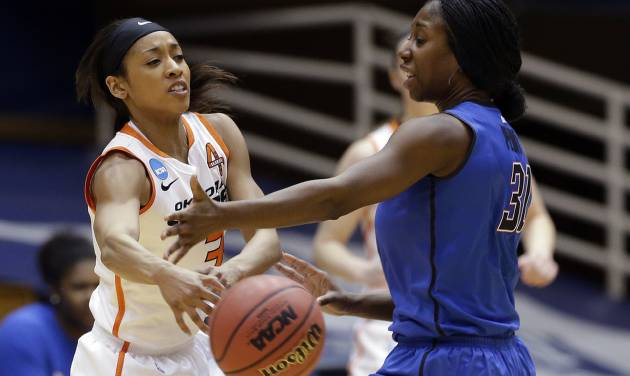 Oklahoma State's Tiffany Bias (3) passes as DePaul's Jasmine Penny (31) defends during the first half of a first-round game in the women's NCAA college basketball tournament in Durham, N.C., Sunday March 24, 2013. (AP Photo/Gerry Broome) ORG XMIT: NCGB117