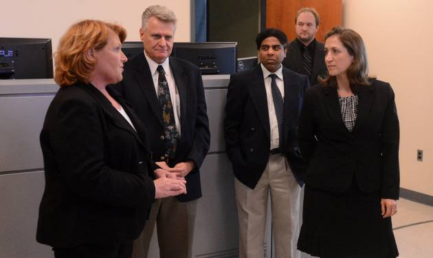 This photo taken April 4, 2014, shows West Virginia Secretary of State Natalie Tennant, right, speaking with Sen. Heidi Heitkamp, D-N.D., left, during a tour of the National Research Center for Coal & Energy on WVU's Evansdale Campus in Morgantown, W.Va.  Tennant hopes her allegiance to West Virginia's coal industry is enough to separate herself from President Barack Obama and retain a Senate seat for Democrats in a state that has sprinted to the right. It's a proven strategy for Democrats in Republican-leaning energy producing states, used by West Virginia's two senators, Joe Manchin and retiring Jay Rockefeller, and their colleagues like Mark Begich in Alaska, Mary Landrieu in Louisiana and Heidi Heitkamp in North Dakota. The question in the November elections is whether that's enough to hold onto a tenuous Senate majority with Republicans gunning for more than a half-dozen seats in states like West Virginia, where Obama lost and remains unpopular.  (AP Photo/The Dominion Post, Matt Sunday)