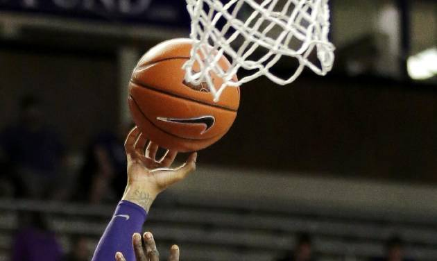 Kansas State guard Rodney McGruder (22) shoots over South Carolina Upstate's Babatunde Olumuyiwa (34) during the second half of an NCAA college basketball game, Sunday, Dec. 2, 2012, in Manhattan, Kan. Kansas State won 72-53. (AP Photo/Charlie Riedel)