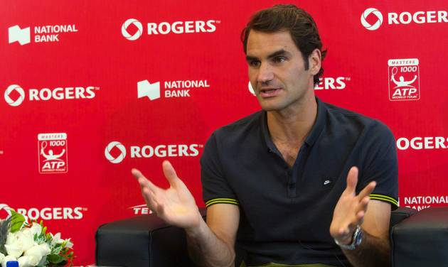 Roger Federer, of Switzerland, gestures during a news conference at the Rogers Cup tennis tournament in Toronto on Sunday, Aug. 3, 2014. (AP Photo/The Canadian Press, Victor Biro)