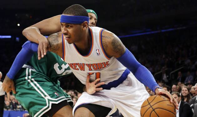 Boston Celtics forward Paul Pierce (34) defends as New York Knicks forward Carmelo Anthony (7) drives to the basket in the first half of their NBA basketball game at Madison Square Garden in New York, Monday, Jan. 7, 2013. (AP Photo/Kathy Willens)