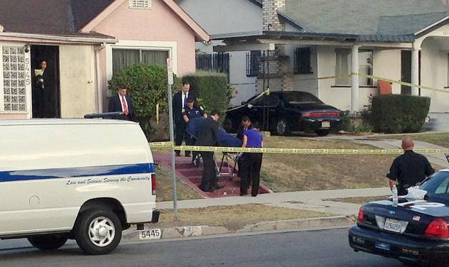 "Los Angeles County coroner's officials remove the body of April Jace, the wife of actor Michael Jace, from the couple's home in the Hyde Park area of Los Angeles Tuesday morning, May 20, 2014. Michael Jace, who played a police officer on the hit TV show ""The Shield,"" was arrested Tuesday on suspicion of shooting his wife to death, authorities said. (AP Photo/Dwight Flowers)"