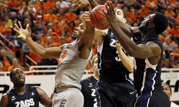 Oklahoma State's Marcus Smart (33) loses the ball against Gonzaga's Kyle Dranginis (3) and Guy Landry Edi (10) as Sam Dower (35) looks on during a men's college basketball game between Oklahoma State University (OSU) and Gonzaga at Gallagher-Iba Arena in Stillwater, Okla., Monday, Dec. 31, 2012. Photo by Nate Billings, The Oklahoman