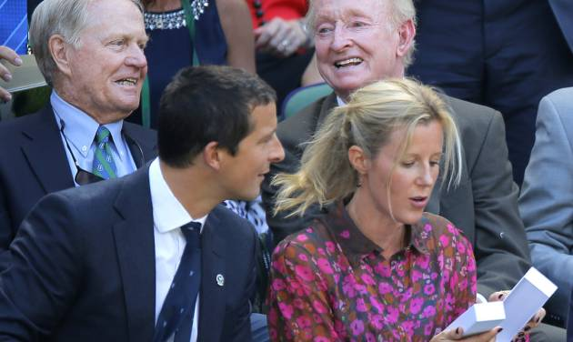 Former golfer Jack Nicklaus, rear left, and former tennis player Rod Laver, rear right, sit in the Royal Box on centre court prior to the men's singles semifinal match between Novak Djokovic of Serbia and Grigor Dimitrov of Bulgaria at the All England Lawn Tennis Championships in Wimbledon, London, Friday July 4, 2014. (AP Photo/Pavel Golovkin)