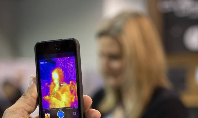The FLIR ONE thermal imager for the iPhone is demonstrated at the International Consumer Electronics Show, Thursday, Jan. 9, 2014, in Las Vegas. The imager attaches to the back of an iPhone 5 or 5s and translates heat data into color images on the phone's screen. (AP Photo/Julie Jacobson)